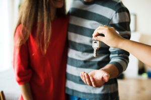 First-time Buyers - Couple receiving keys to new house.